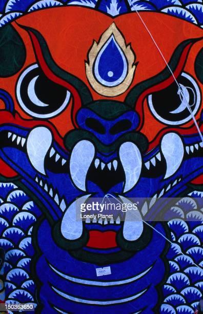 Detail of artwork on kites for sale in gardens of Sanam Luang in Ratanakosin.