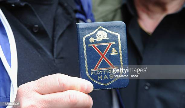 A detail of badge of fascist fighters at commemoration ceremony for the death of Italian dictator Benito Mussolini and his mistress Claretta Petacci...