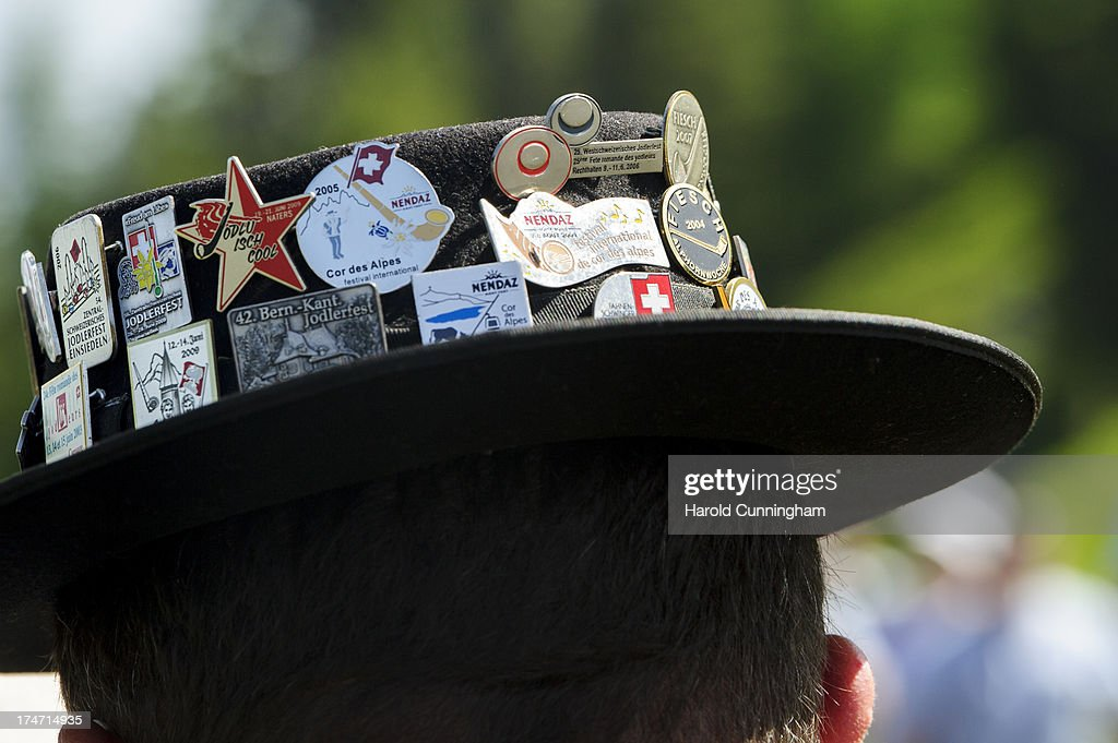 A detail of badges attached to the hat of an alphorn player on July 28, 2013 in Nendaz, Switzerland. About 150 alphorn blowers performed together on the last day of the international Alphorn Festival of Nendaz. The Swiss folkloric wooden wind instrument was used in most mountainous regions of Europe by mountain dwellers as signal instruments.