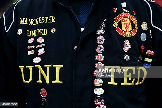 Detail of badges on a fan's jacket prior to the Barclays Premier League match between Manchester United and Chelsea at Old Trafford on October 26...