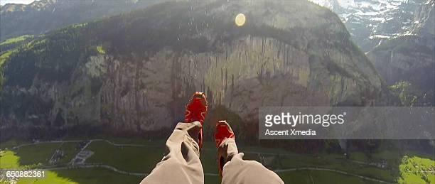 Detail of BASE jumper's feet, doing aerial flip