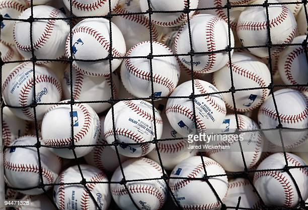 A detail of baseballs is seen through netting of a basket during Game One of the 2009 MLB World Series between the New York Yankees and the...