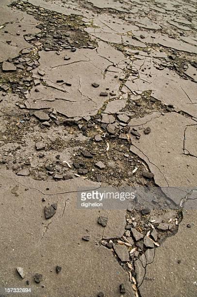 Detail of broken asphalt pavement