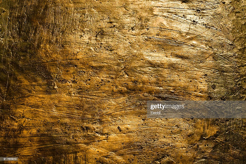 Detail of brushed bronze-colored wall : Stock Photo