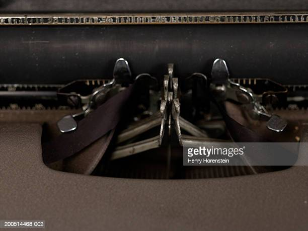 Detail of carriage of old typewriter with jammed keys