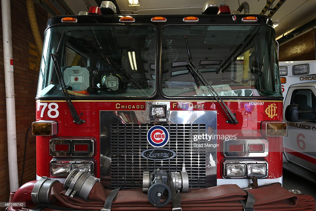 Detail of Chicago Fire Department fire truck with Chicago Cubs logo across the street from Wrigley Field on Waveland Avenue during the game between...