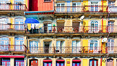 Detail of colorful building facades and balconies in Ribeira area of historic Porto, Portugal