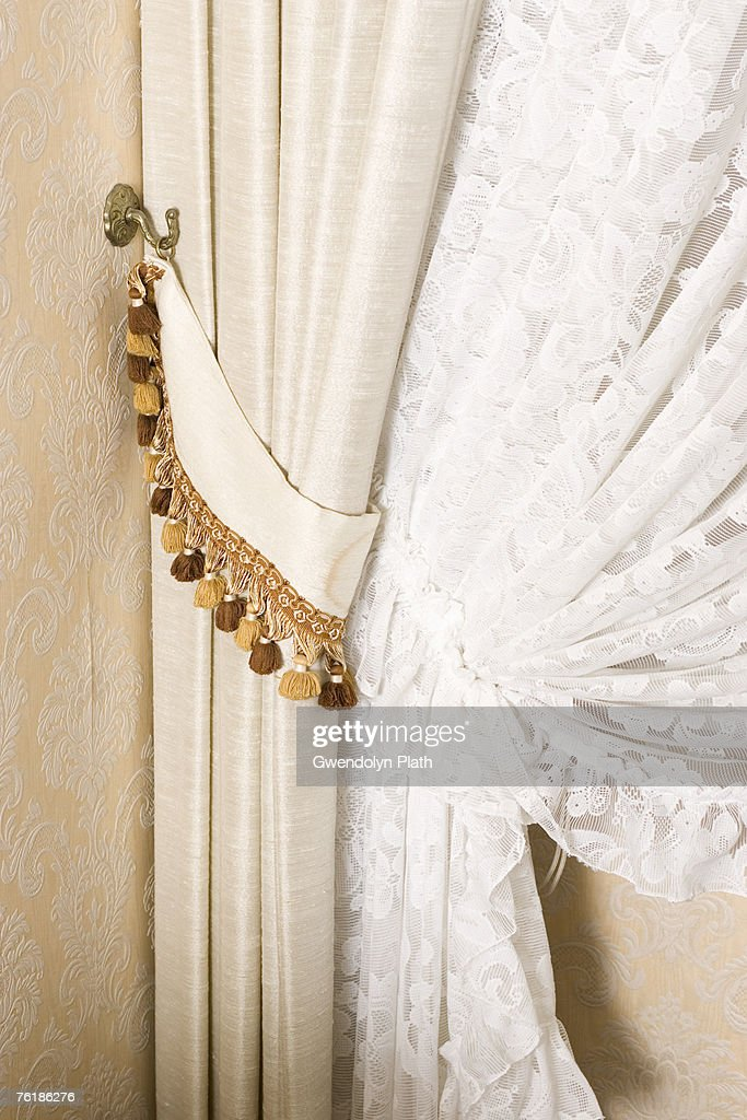 Detail Of Curtains Drawn Back : Stock Photo