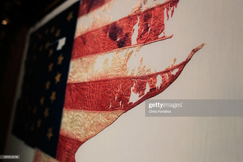 A detail of 'Custer's Last Flag' is seen in a frame at Sotheby's auction house December 3, 2010 in New York City. The flag, one of the few remnants of the famous 1876 battle in which General George Custer and his men were slaughtered by a band of Native American warriors after he staged a misgiuded attack, is billed as 'the most significant and symbolic artefact recovered from the Little Bighorn battlefield' and is scheduled to be auctioned on December 10.