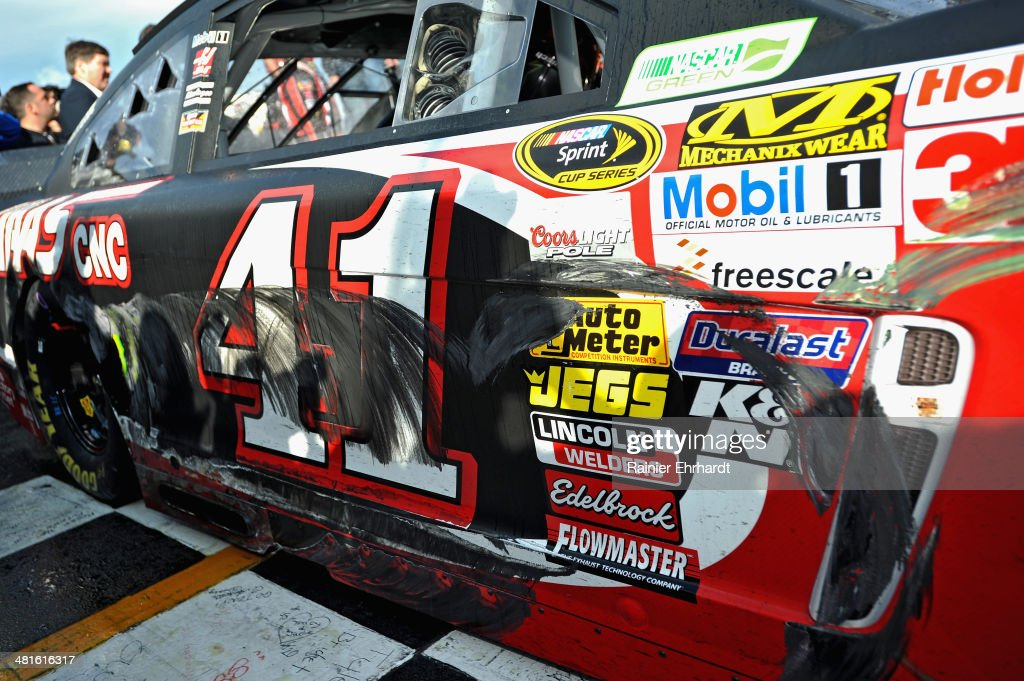 A detail of damage to the #41 Haas Automation Chevrolet of Kurt Busch is seen in Victory Lane after he won the NASCAR Sprint Cup Series STP 500 at Martinsville Speedway on March 30, 2014 in Martinsville, Virginia.