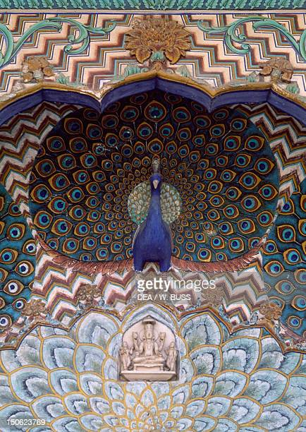 Detail of decoration depicting a peacock City Palace Jaipur India
