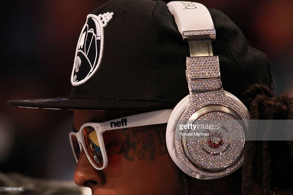 A detail of Diamond studded Beats headphones by Dr Dre are worn courtside by hiphop artist Lil' Wayne during the 2012 NBA AllStar Game at the Amway...