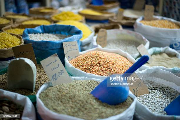 A detail of different grains for sale in the souk in Tangier, Morocco.