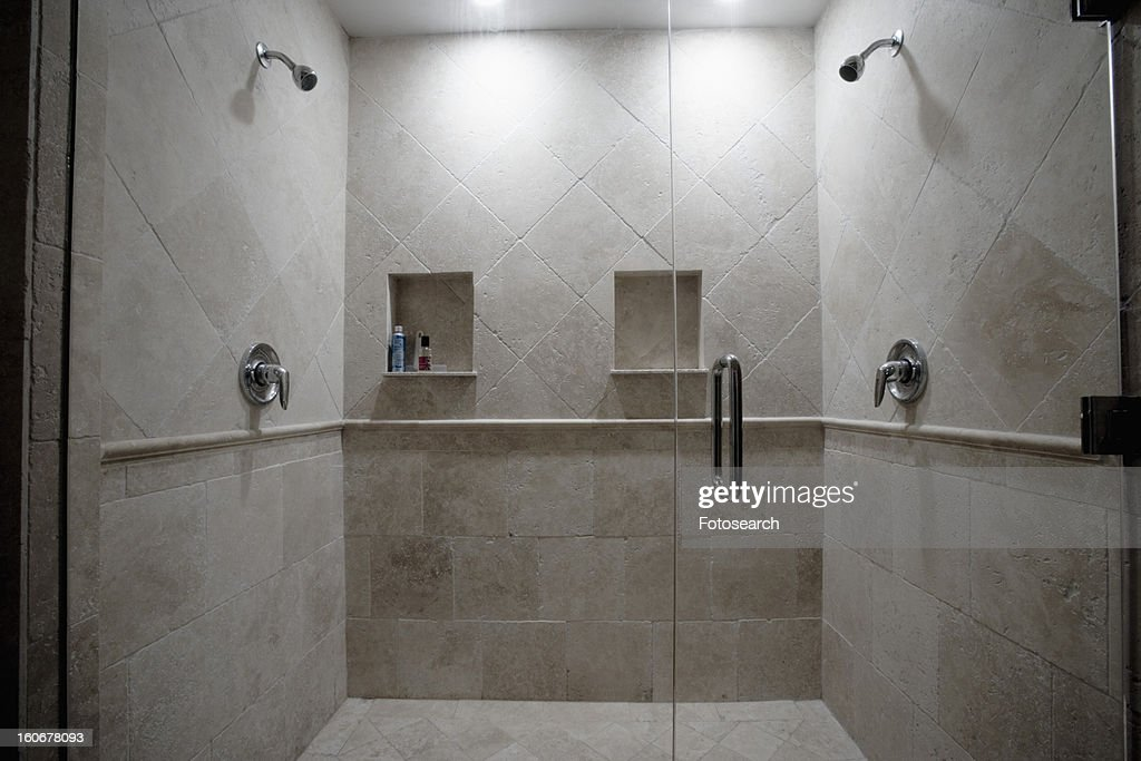detail of dual stone showers with glass door stock photo. Black Bedroom Furniture Sets. Home Design Ideas