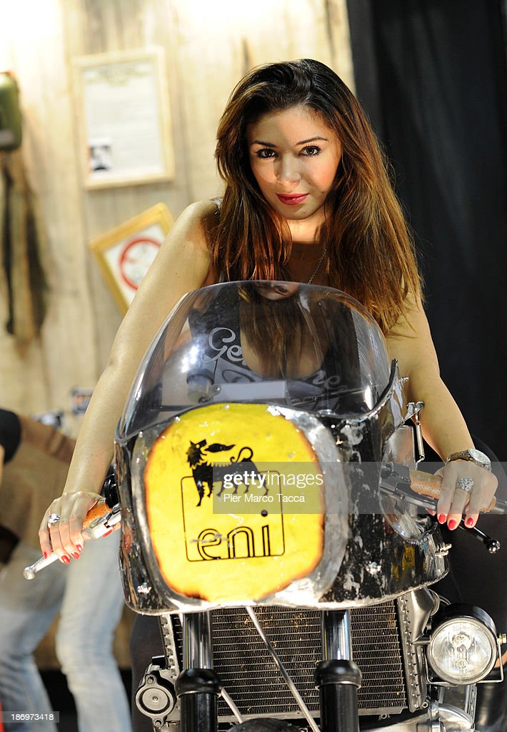 A detail of ENI logo with a model is displayed during the EICMA 2013 71st International Motorcycle Exhibition on November 5, 2013 in Milan, Italy.