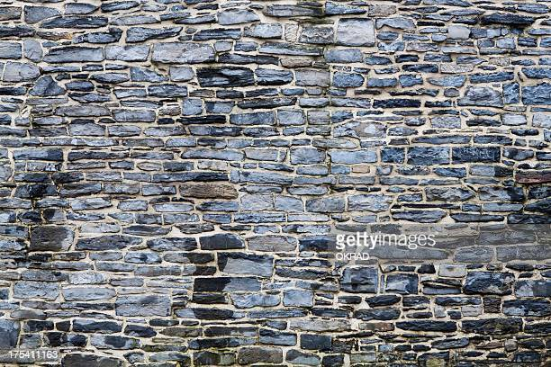 Detail of exterior dark stone wall background
