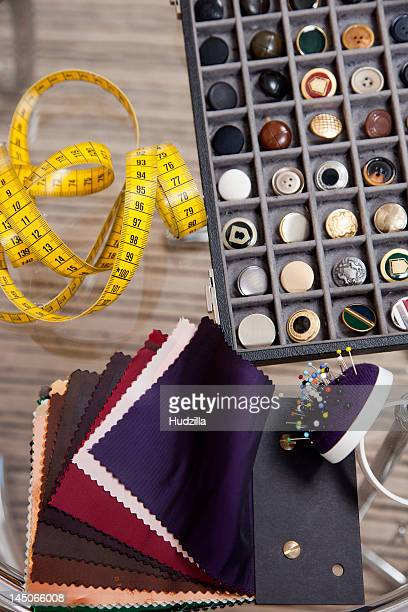 Detail of fabric samples, buttons, and other sewing equipment