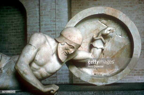 Detail of fallen warrior from the East Pediment of Temple of Aphaia Aegina Greece c500c480 BC This item is now in the Munich Glyptothek Germany