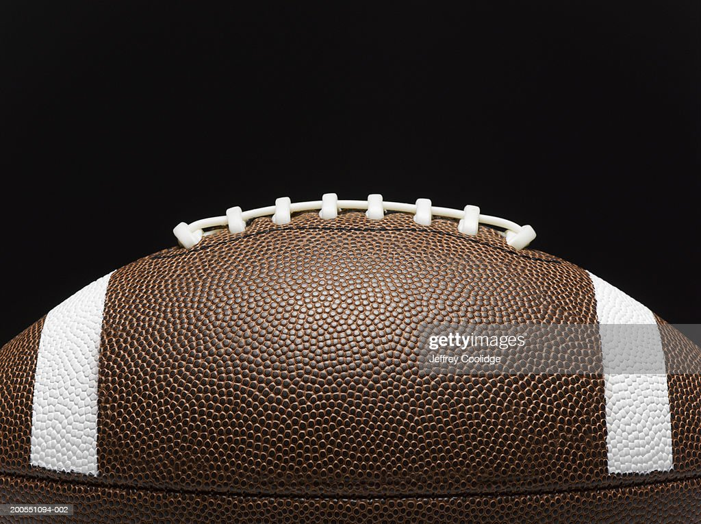 Detail of football and laces, side view