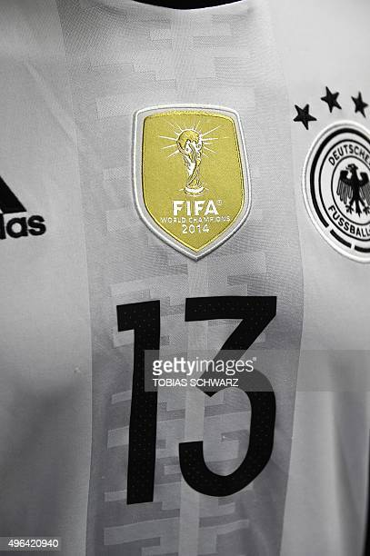 detail of Germany's football jersey for the EURO 2016 football championships shows a sticker reading 'FIFA World champions 2014' during the...