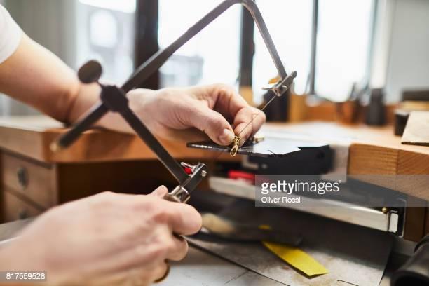Detail of goldsmith at work in her workshop
