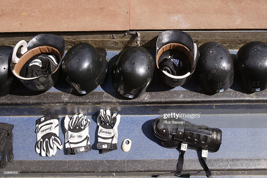 Detail of helmets, gloves, and a knee guard during the game between the Boston Red Sox and the Toronto Blue Jays at Skydome on May 16, 2004 in Toronto, Canada. The Blue Jays won 3-1.