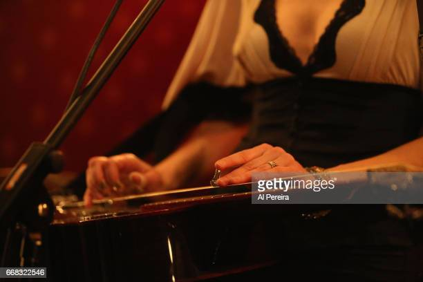 Detail of her hands on the Dobro when Abbie Gardner and her band perform her 'Get Ready For Recording' Show at Pete's Candy Shop on April 13 2017 in...