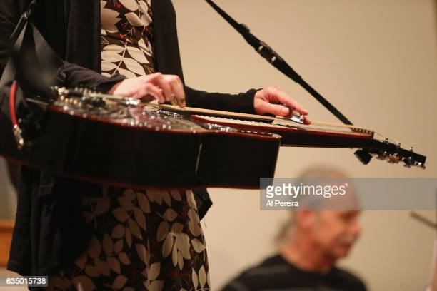 Detail of her hands on the Dobro when Abbie Gardner performs as part of the 'Remembering Jack Hardy' Celebration at Long Island Museum on February 12...