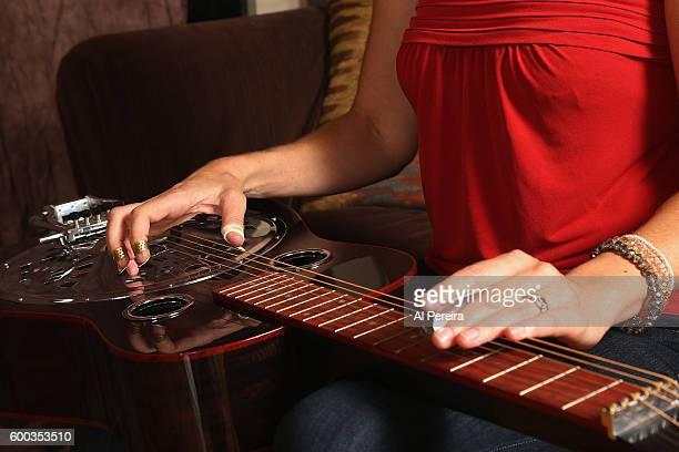 Detail of her hands playing slide on the Dobro when Musician Abbie Gardner appears in a portrait taken at Rhino's Den Studio on September 7 2016 in...