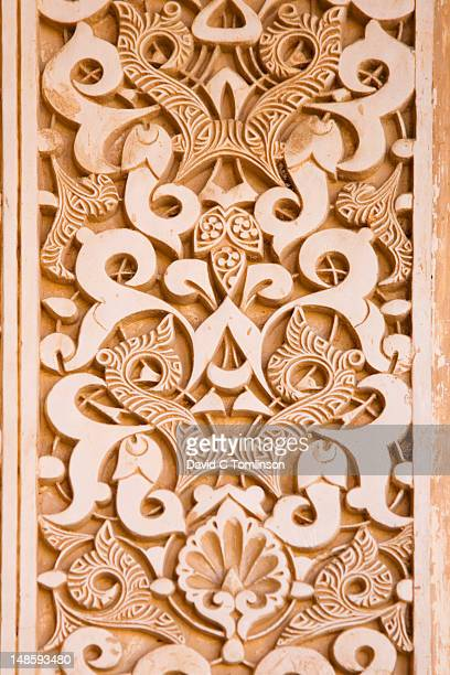 Detail of intricately moulded stucco wall panel in the Patio de los Leones, Casa Real (also known as Palacios Nazaries), at the Alhambra.