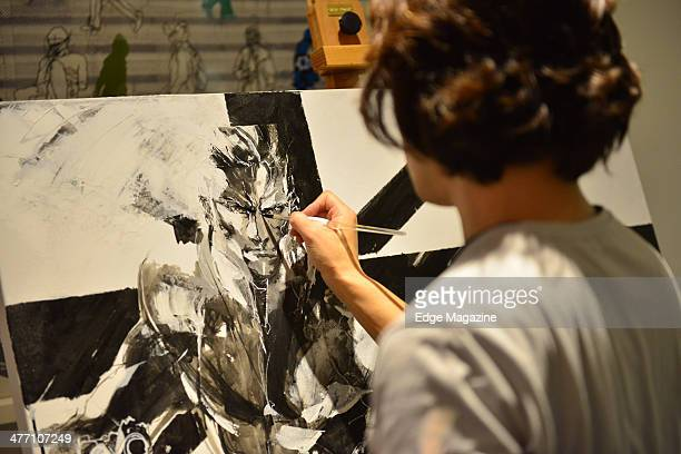 Detail of Japanese artist Yoji Shinkawa painting in London on February 22 2013 Shinkawa is best known as the conceptual designer for much of the...