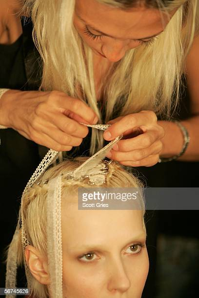 Detail of model's hair as they prepare backstage at the Sass Bide Fall 2006 fashion show at Bryant Park during Olympus Fashion Week on February 4...