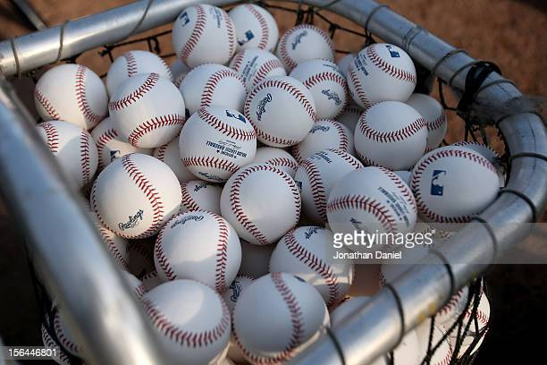 A detail of officiall major league baseball postseason baseballs are seen in a bucket during batting practice between the New York Yankees and the...
