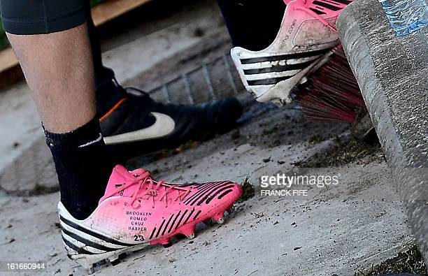 Detail of Paris SaintGermain's British midfielder David Beckham's shoes with the name of his four children on it taken during a training session on...
