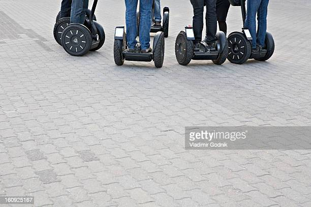 detail of people using segways