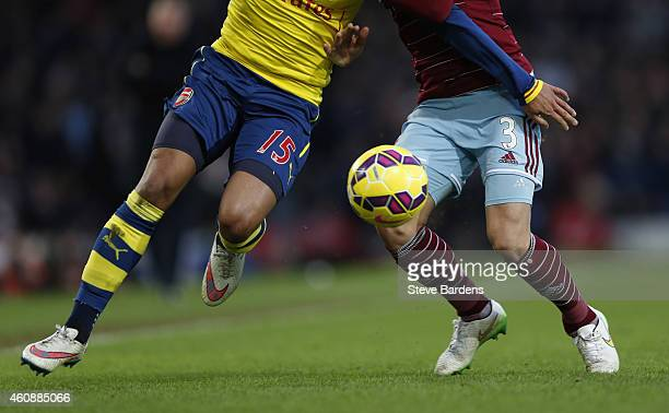 Detail of players legs boots and match ball during the Barclays Premier League match between West Ham United and Arsenal at Boleyn Ground on December...