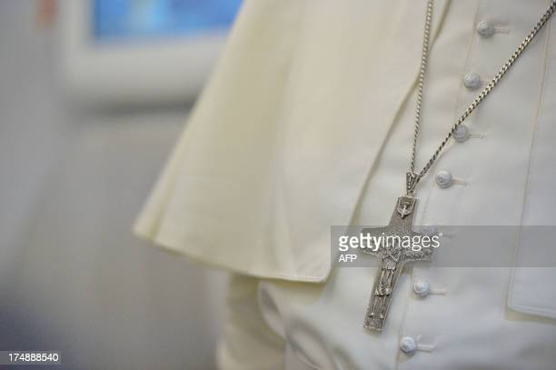 Detail of Pope Francis' crucifix during a long press conference held aboard the papal flight on their way back to Italy upon departure from Rio de...