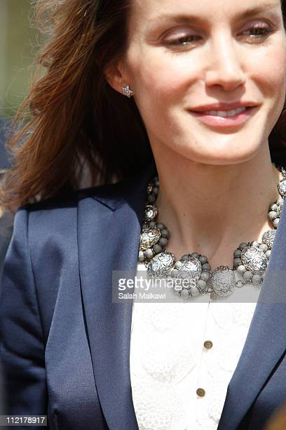 A detail of Princess Letizia of Spain's necklace is seen a she departs after a threeday visit at Queen Alia airport on April 14 2011 near Amman...