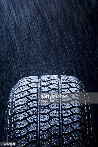 Detail of rain falling on a car tire