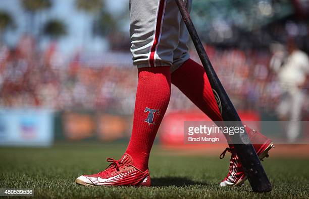 DEtail of red socks worn by Freddy Galvis of the Philadelphia Phillies as he walks to the on deck circle during the game against the San Francisco...