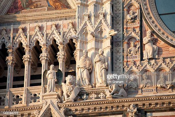 Detail of religious statues and gargoyles on Il Duomo di Siena the Cathedral of Siena Italy#13#10