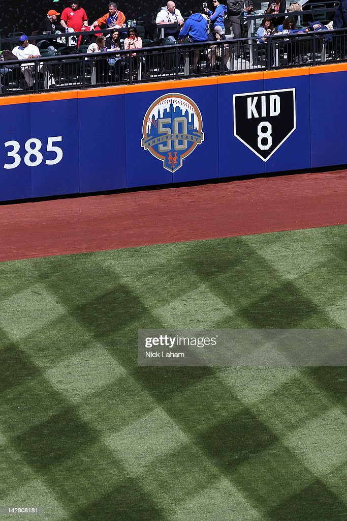A detail of signs on the outfield wall honoring the 50th anniversary of the New York Mets and a sign in honor of the late former Mets' catcher and Hall of Famer Gary Carter which reads 'Kid 8' against the Atlanta Braves during their Opening Day Game at Citi Field on April 5, 2012 in New York City.