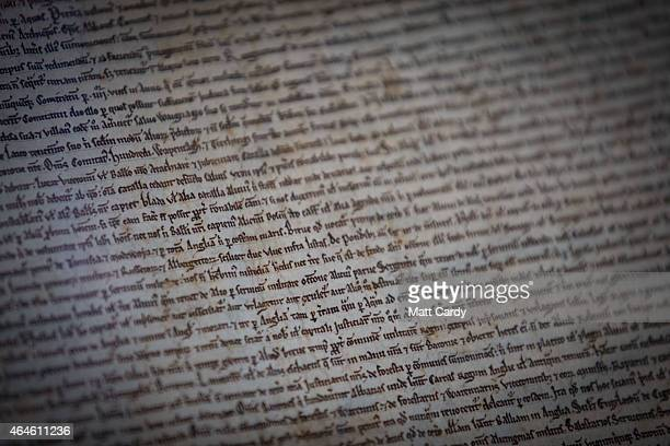 Detail of text is seen on a copy of the Magna Carta in Salisbury Cathedral's Cloisters and Chapter House on February 27 2015 in Salisbury England To...