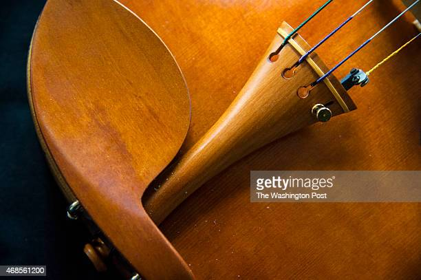 A detail of the 400th instrument that Robert McCluskie created by hand a violin made from red maple and red spruce is photographed at his home March...