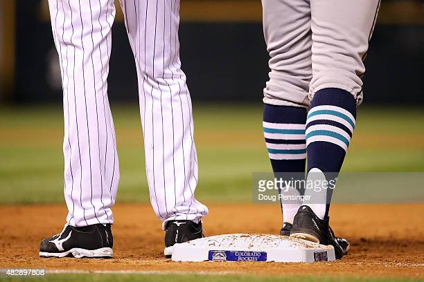A detail of the action as first baseman Ben Paulsen of the Colorado Rockies holds Brad Miller of the Seattle Mariners on firstbase during interleague...