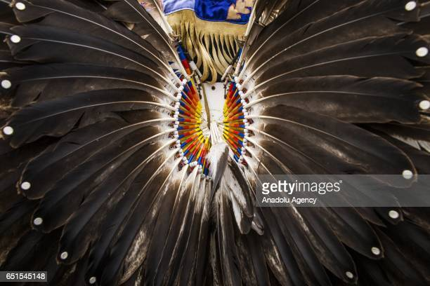 A detail of the back of Native American man's traditional garb in front of the White House while protesting the construction of the Dakota Access...