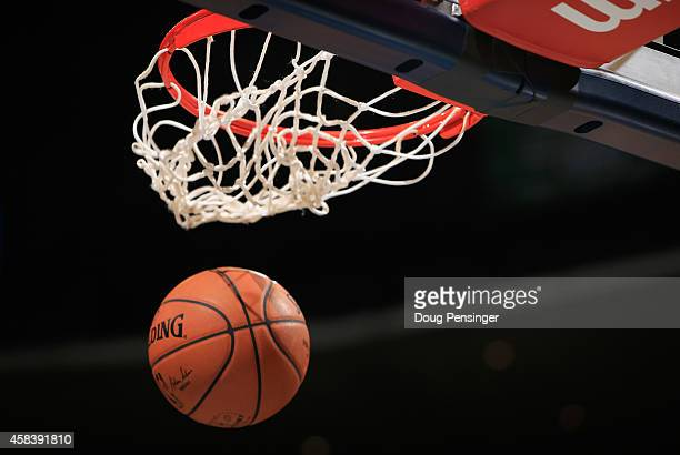 Detail of the ball as it goes through the basket as the Sacramento Kings warm up to face the Denver Nuggets at Pepsi Center on November 3 2014 in...