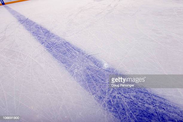 A detail of the blue line as the ice sheet is prepared for the game as the Calgary Flames prepare to face the Colorado Avalanche at the Pepsi Center...