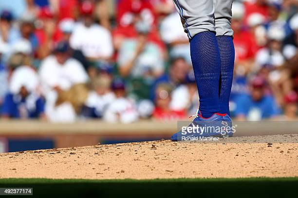Detail of the blue socks worn by RA Dickey of the Toronto Blue Jays as he pitches in the fourth inning against the Texas Rangers in game four of the...