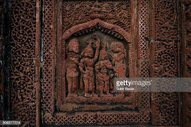 Detail of the carved  terracotta work in the Madanmohan Temple,Bishnupur, West Bengal, India, Asia.